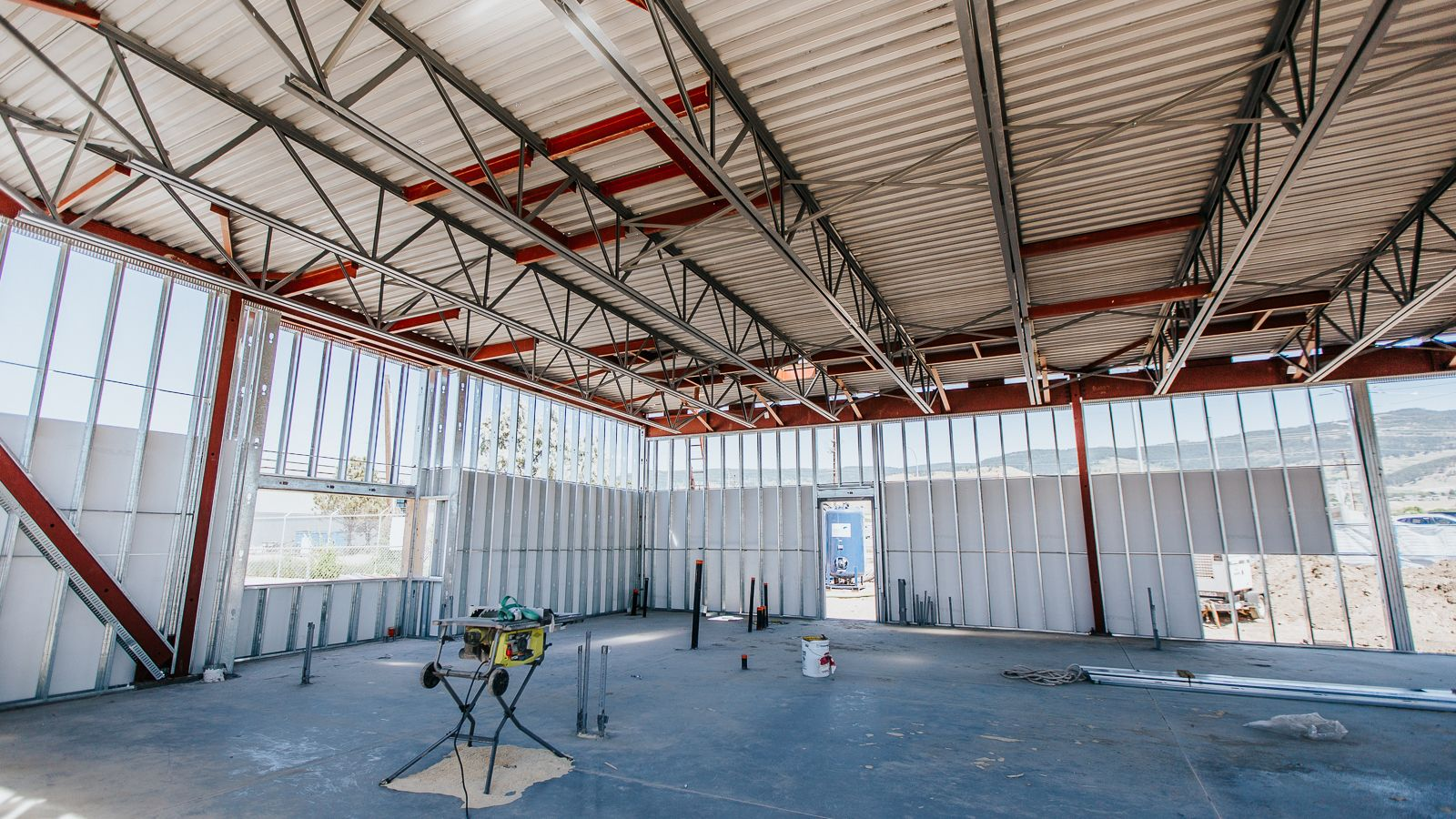 A large room with steel framing installed by Kelco Drywall Ltd, where safety is the top priority