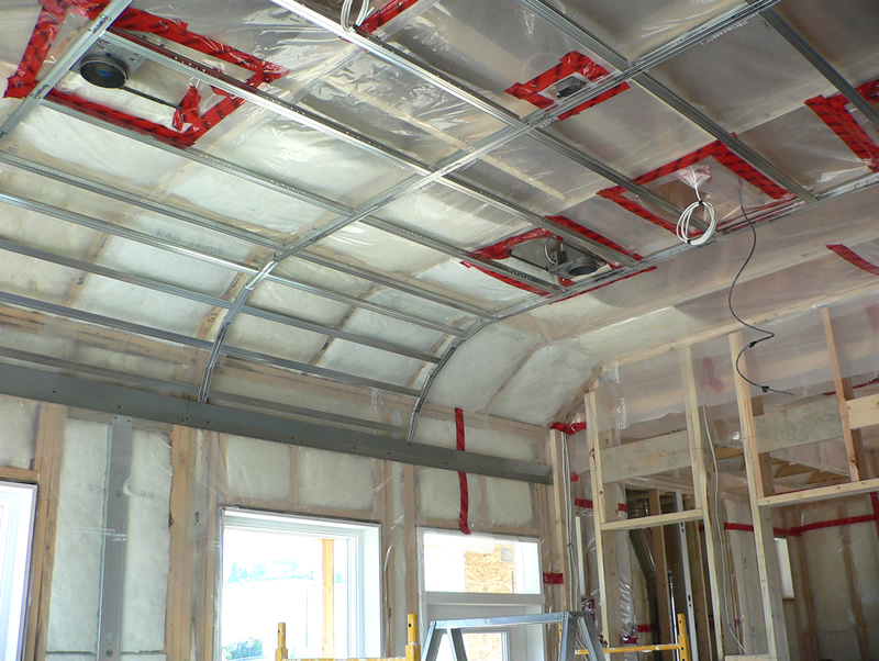 A room with specialty framing by Kelco drywall, which is framed with metal framework and plastic sheets.