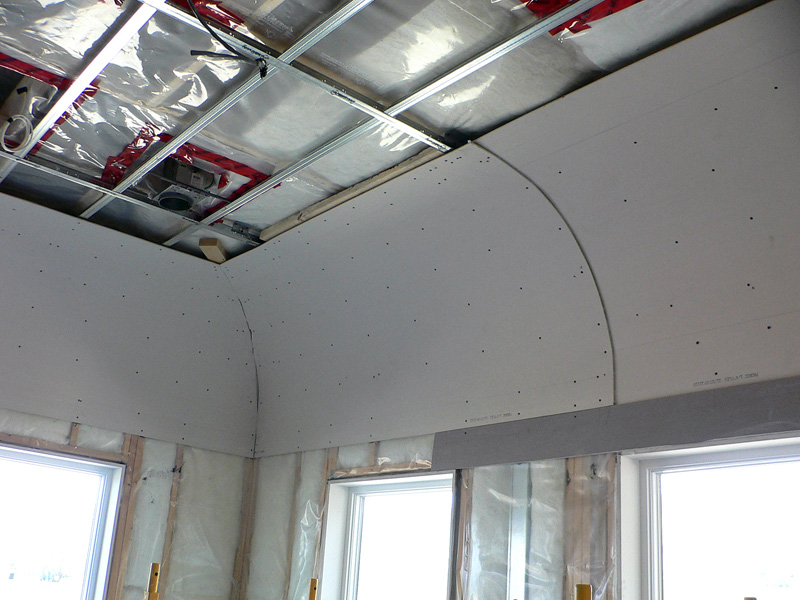 An example of Kelco Drywall's specialty frmaing installation, with metal frames and wooden sheets.