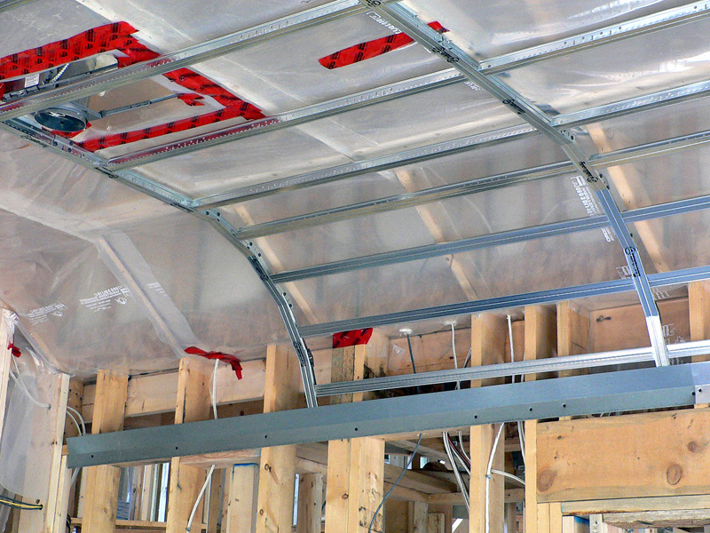 A room midway through installation specialty framing by Kelco Drywall, which has metal frames for a curved ceiling room.