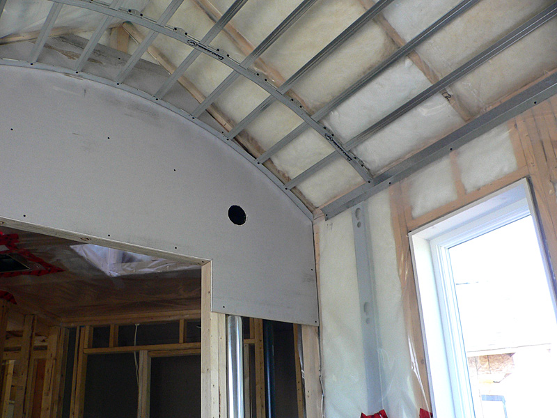 An example of Kelco Drywall's specialty framing installation in a room with a curved ceiling.