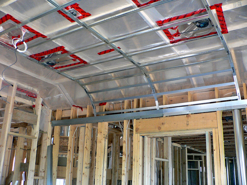 An example of one of Kelco Drywall's specialty framing jobs, n a room with a curved ceiling, using metal and wooden frames to create the curved shape in the ceiling.